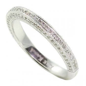 Beautiful and fashionable White Gold ladies' wedding band with Pave Diamonds on top and gallery sides