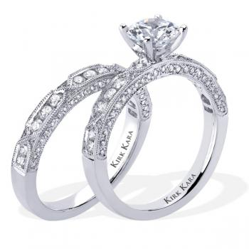 Designer diamond engagement ring and matching band