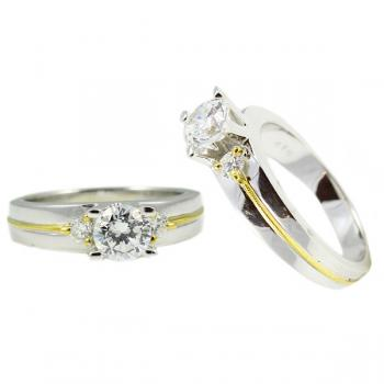 Elegant 4-prong White and Yellow Gold Diamond engagement ring with single round Diamonds on each side and Yellow Gold beading down the center