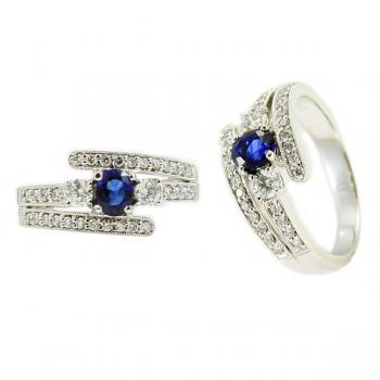 Shimmering and graceful Diamond and Sapphire ring set in White Gold
