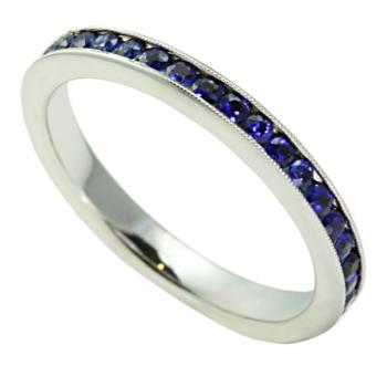 Gracefully exquisite Blue Sapphire Ladies' wedding band set in White Gold
