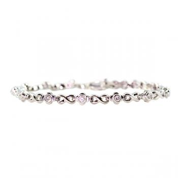 Dazzling Platinum and bezel cut Diamond bracelet with alternating figure eight links