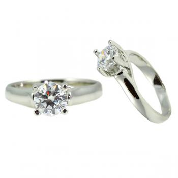 Simple 4-prong Platinum engagement ring with a small diamond in each prong.