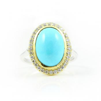A beautifully distinctive two-tone ring with a center Persian Turquoise surrounded by Diamonds