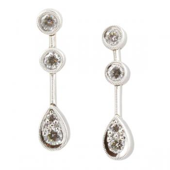 Stunning three-stone line Diamond earrings with a pear shaped Diamond drop