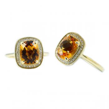 Enticing Citrine and Diamond ring set in Yellow Gold