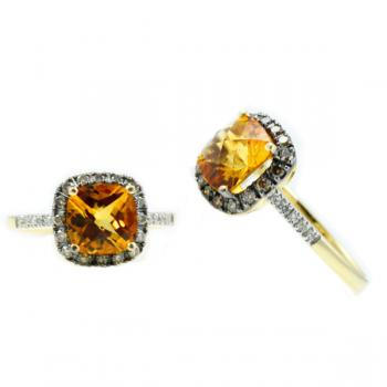Lovely and fascinating cushioned shaped Citrine ring surrounded with Champagne Diamonds and White Diamonds in the shank