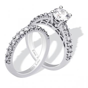Classic diamond engagement ring and matching band