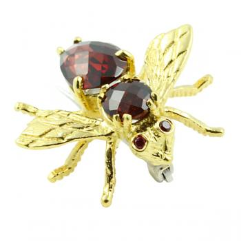 Charming Rhodolite bee pin that adds a fun touch to any outfit