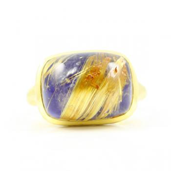 Sophisticated and modern Rutilated Quartz and Lapis ring set in hammered 18K Gold