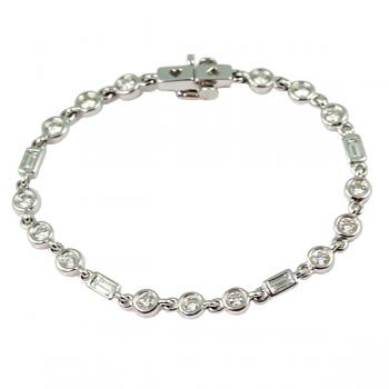 Beautiful Diamond bracelet with three round bezel cut Diamond links alternating with one bezel cut baguette link