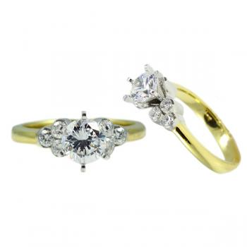 Striking 4-prong Platinum semi-mount Diamond engagement ring with 3 Diamond baguettes triangle sides