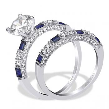 Diamond engagement ring accented with sapphire baguettes with matching band.