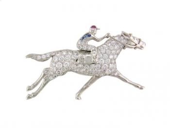 Classically charming horse and jockey Diamond, Sapphire and Ruby pin set in Platinum
