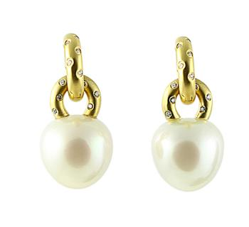 Exquisite, sophisticated Pearl and Diamond earrings set in 18K Gold�two pairs of earrings in one�Gold and Diamond hoops can be worn separately or