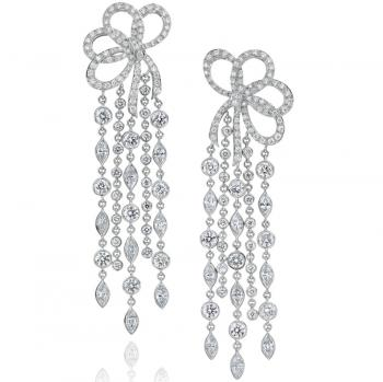 PLATINUM AND DIAMOND BOW STYLE EARRINGS